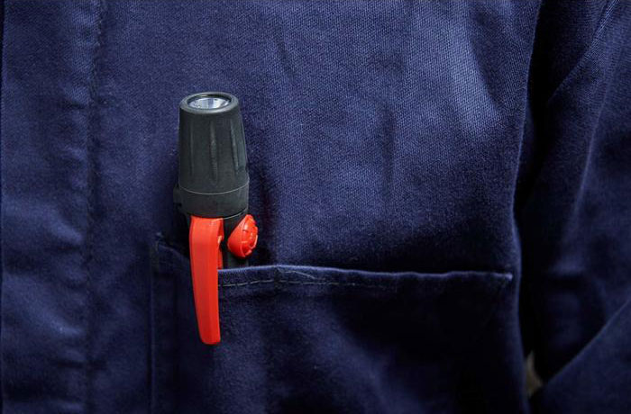 Fluke FL-45 EX Intrinsically Safe Flashlight, 45 lumens inside a shirt pocket